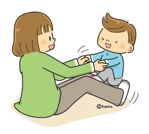足の上でゆらゆらする子供と先生(カラー)